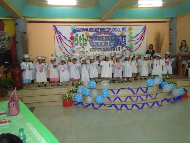 Kindergarten children presenting their graduation song